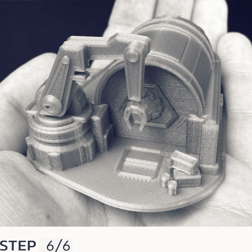 Holding the fully assembled 3D printed model in your hands